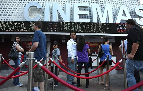 AMC has decided to turn the screws on some of its best customers by charging them more for certain shows at certain theaters. Above, the Universal Citywalk.