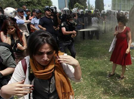Police officers douse a woman with tear gas spray in Istanbul during days of heavy rioting against what many view to be an overly authoritarian government led by Prime Minister Tayyip Erdogan.