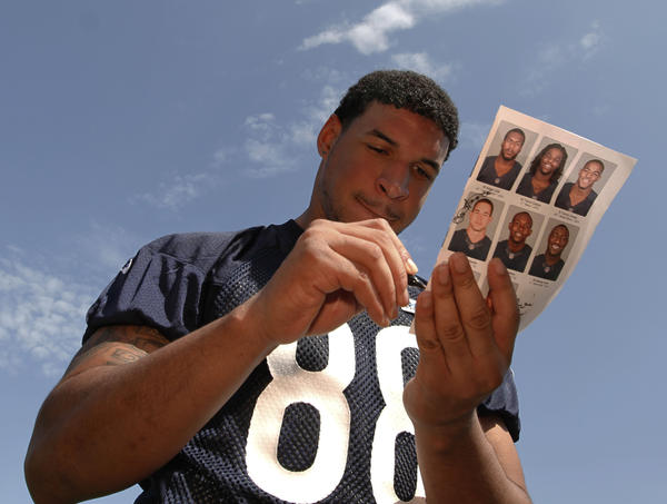 Evan Rodriguez signs autographs after his first Bears rookie camp in 2012.