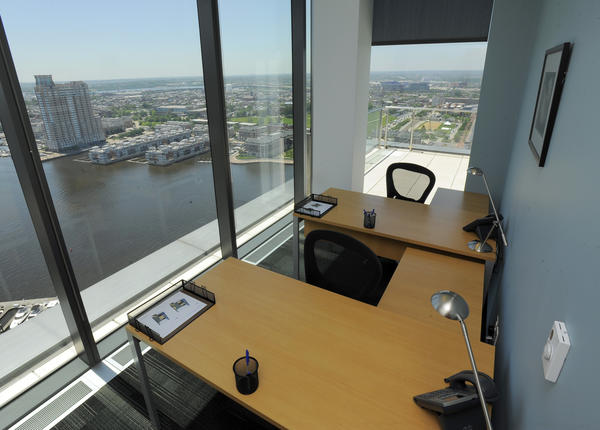 Shown is a private office available in a Regus business center on the 23rd floor of the Legg Mason Tower in Harbor East.