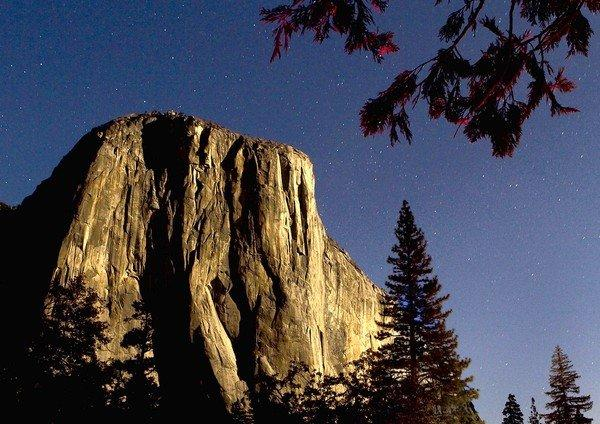 El Capitan is shown on a moonlit night. A man climbing the massive formation was killed Sunday when he was struck by a falling rock.