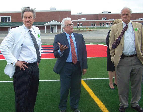 West Virginia School Building Authority Executive Director Mark A. Manchin (left) and School Building Authority board member Robert Dunlevy (right) tour the new Spring Mills High School campus Monday with Berkeley County Schools Superintendent Manny P. Arvon after the SBA boards meeting at Spring Mills Primary School.