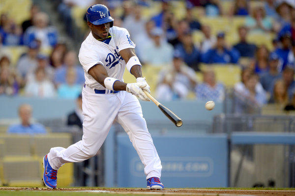 Dodgers' Yasiel Puig singles in his first major-league at-bat during the first inning.