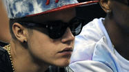 Pop star Justin Bieber was spotted at American Airlines Arena on Monday night for Game 7 of the NBA Eastern Conference Finals as the Miami Heat faced off against the Indiana Pacers.
