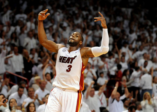 Miami Heat's Dwyane Wade gets the crowd going as the team pulls away from the Indiana Pacers during the third quarter.