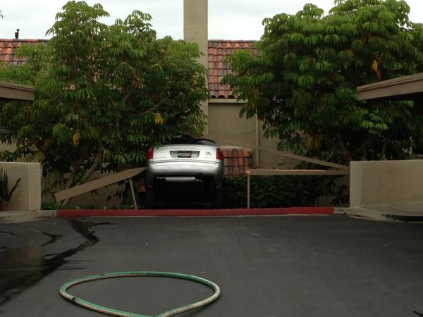A silver minivan crashed into a building in Newport Beach on Monday evening.