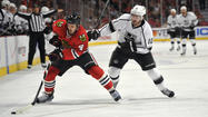 LOS ANGELES — Already offensively challenged, the Kings were without their leading scorer in the playoffs, <strong>Mike Richards</strong>, for Game 3 of the Western Conference finals against the Blackhawks.