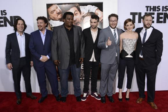 Paul Rudd, left, Danny McBride, Craig Robinson, Jay Baruchel, Seth Rogen, Emma Watson and Evan Goldberg.