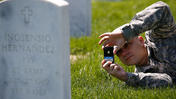 U.S. Army volunteers use iPhones to photograph gravestones