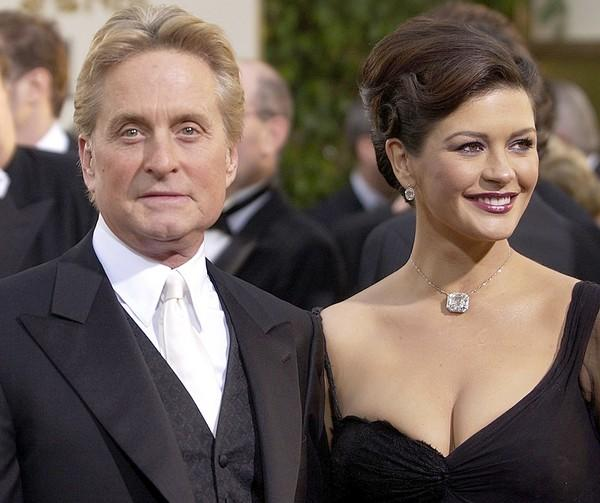 Actors Michael Douglas and his wife Catherine Zeta-Jones arrive for the 60th Annual Golden Globe Awards in Beverly Hills, Calif.