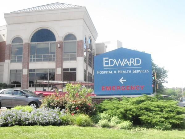 Naperville Unit District 203 owes $2.2 million to Edward Hospital due to a change in state law.