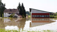 DRESDEN, Germany/LITOMERICE, Czech Republic (Reuters) - Tens of thousands of Germans, Hungarians and Czechs were evacuated from their homes on Wednesday as soldiers raced to pile up sandbags to hold back rising waters in the region's worst floods in a decade.
