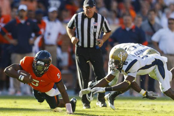 Oct 15, 2011; Charlottesville VA, USA;  Virginia Cavaliers quarterback David Watford (5) dives for extra yardage in front of Georgia Tech Yellow Jackets cornerback Rod Sweeting (right) during the second quarter at Scott Stadium.  Mandatory Credit: Jason O. Watson-US PRESSWIRE ORG XMIT: USPW-34762