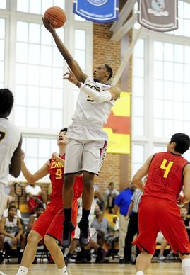 July 13, 2012;Alexandria, VA USA;USA East forward Troy Williams (9) lays the ball up over China forward Li Jinglong (9) and LI Bin (4) during the Nike Global Challenge at Episcopal High School. Mandatory Credit: Evan Habeeb-US PRESSWIRE ORG XMIT: USPW-92126