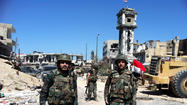 Syrian army, backed by Hezbollah, retakes key town of Qusair