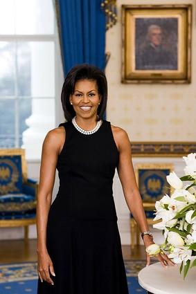 the official portrait of first lady Michelle Obama taken in the Blue Room of The White House.