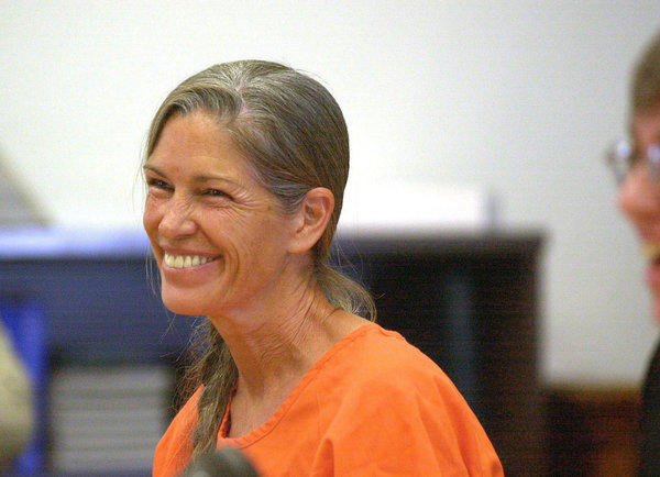 Leslie Van Houten smiles during a 2002 court hearing in San Bernardino.