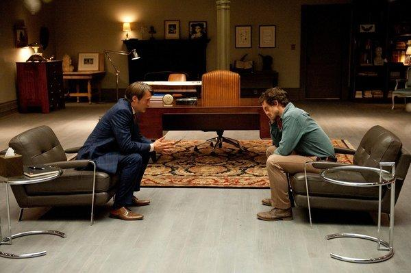 Psychiatrist and serial killer Hannibal Lecter (Mads Mikkelsen, left) and FBI profiler Will Graham (Hugh Dancy) talk in the doctor's chambers, based on an old library room in a North Carolina state building.