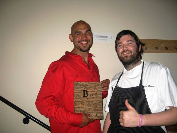 Robert Sacre stands with chef Bernhard Mairinger.