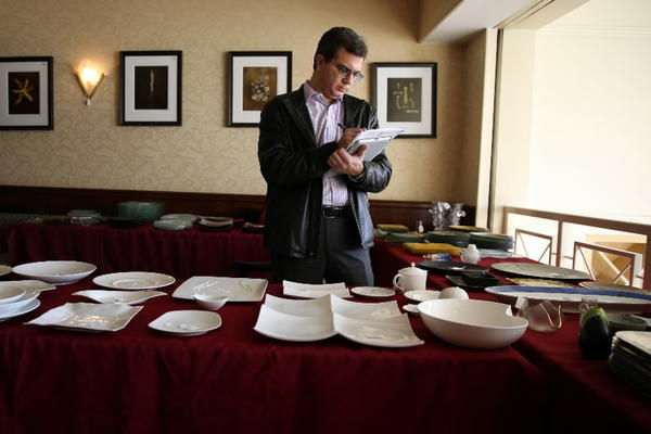 Serving dishes and dinnerware on display during the auction at Charlie Trotter's, 816 W. Armitage Ave., on Wednesday. The auction consisted of about 1,500 lots including stemware, dinnerware, kitchen equipment, chairs, tables and artwork.