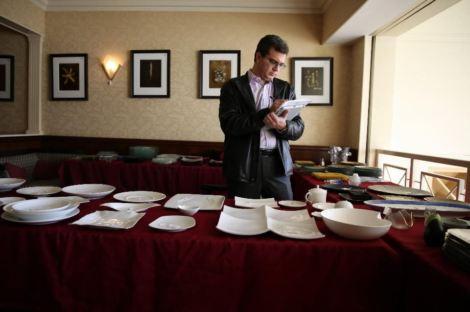 <p>Serving dishes and dinnerware on display during the auction at Charlie Trotter's, 816 W. Armitage Ave., on Wednesday. The auction consisted of about 1,500 lots including stemware, dinnerware, kitchen equipment, chairs, tables and artwork.</p>