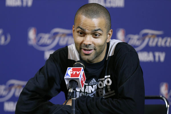 Spurs point guard Tony Parker addresses the media before practice.