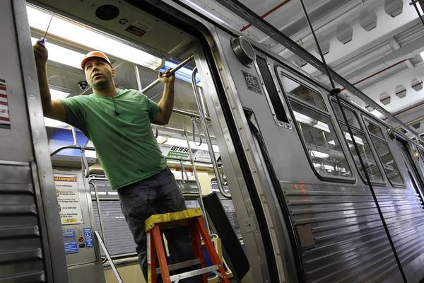 Derek Stawikoski of Bombardier Transportation works on a 5000 Series CTA train at the CTA repair facility in Forest Park.