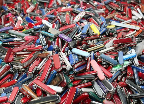 The TSA plan would have allowed folding knives with blades less than 2.36 inches long and half an inch wide. There were no plans to lift the ban on box cutters and other blades. Above, knives of all types and sizes confiscated at Hartsfield-Jackson Atlanta International Airport are shown at Georgia Surplus Property Division store in Tucker, Ga.