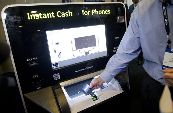 An ecoATM is shown at a demonstration in Washington. City Council members in Baltimore want to ban such devices, but the company says it is being unfairly targeted.