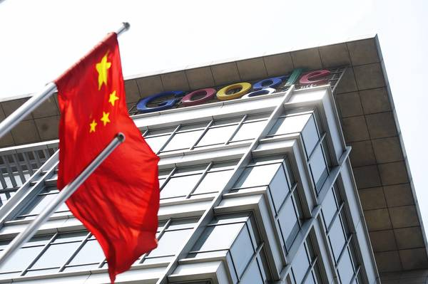 A Chinese flag flies in front of Google's offices in Beijing in 2011. Google was the first major company to publicly accuse China of a vast cyber intrusion.