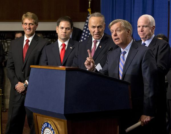 Sen. Lindsey Graham (R-S.C.) speaks about the immigration bill in April. With him are, from left, Sens. Jeff Flake (R-Ariz.), Marco Rubio (R-Fla.), Charles E. Schumer (D-N.Y.) and John McCain (R-Ariz.).