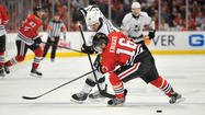 LOS ANGELES — The sight of <strong>Mike Richards</strong> taking the ice Wednesday was encouraging for the Kings, though the veteran center's status for Game 4 of the Western Conference finals against the Blackhawks remains in question.