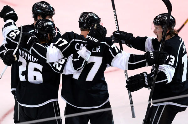 Kings teammates Dustin Penner, left, Slava Voynov, Jeff Carter and Tyler Toffoli celebrate after Voynov scored against the Blackhawks in the second period of Game 3 on Tuesday night.