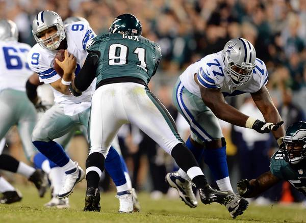 The Eagles' Fletcher Cox (91) brings down Dallas quarterback Tony Romo in a game last season. Cox is confident he can make plays from any position the coaches put him in.
