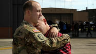 Soldiers from the 143<sup>r</sup><sup>d</sup> Military Police Company of West Hartford returned from a year-long deployment in Afghanistan Wednesday, the first of several homecomings that will occur this summer as the military continues its exit strategy from America's longest war.