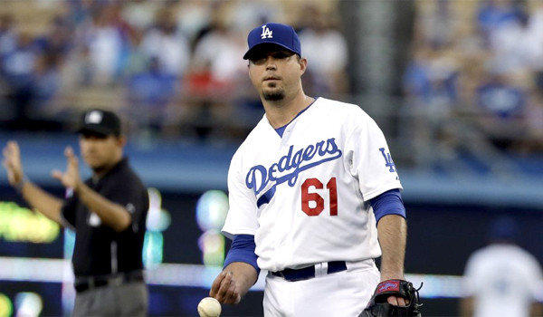 """Josh Beckett will be shut down for the next four weeks while he undergoes """"aggressive rehabilitation"""" to determine whether he'll be able to pitch again this season."""