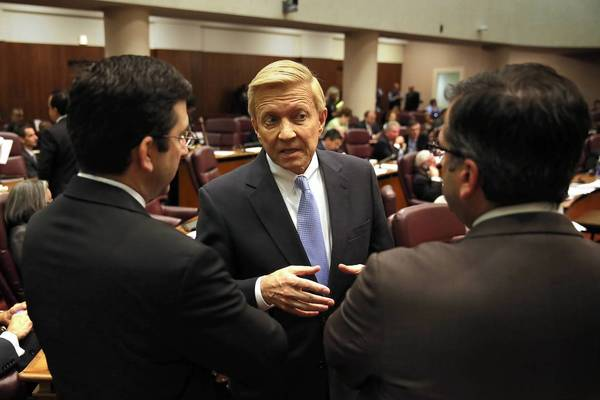 Aldermen, from left, Scott Waguespack, 32nd, Bob Fioretti, 2nd, and John Arena, 45th, all who voted no on the parking ordinance, talk after the vote and before the City Council meeting ended Wednesday.