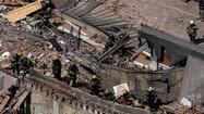 PHILADELPHIA — A building that was being torn down collapsed with a thunderous boom Wednesday, raining bricks on a neighboring thrift store, killing six people and injuring at least 13 others in an accident that witnesses said was bound to happen.