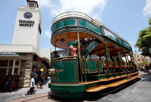 And old-fashioned trolley ferries visitors through the Grove shopping center. Rick Caruso envisions expanding it to other sites in the neighborhood.