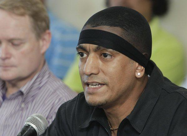 A January 2013 photo shows alleged MS-13 gang leader Borromeo Enrique Henriquez Solorzano at a news conference at a prison in El Salvador. He was named by the U.S. Department of Treasury as a leader of the transnational gang.