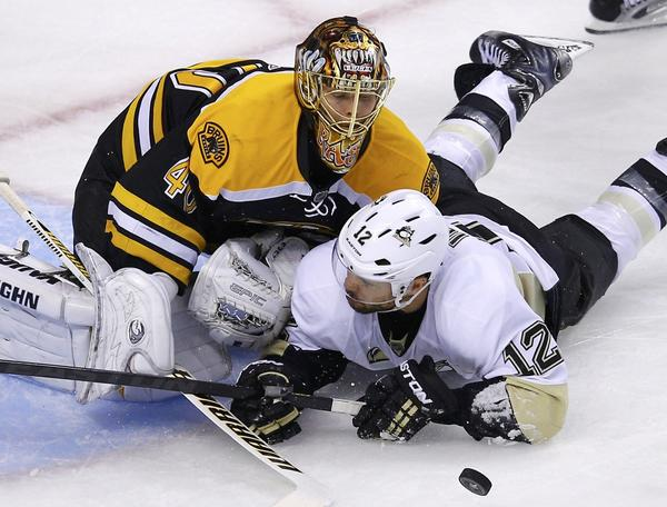 Bruins goalie Tuukka Rask makes a save on the Penguins' Jarome Iginla during the second overtime.