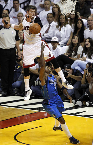 Miami's Mike Miller (13) leaps over Dallas Mavericks shooting guard Jason Terry (31) in the first half during Game 1 of the 2011 NBA Finals. Miller and his Heat teammates will be in the NBA Finals for the third year in a row starting at 8 tonight on ABC.