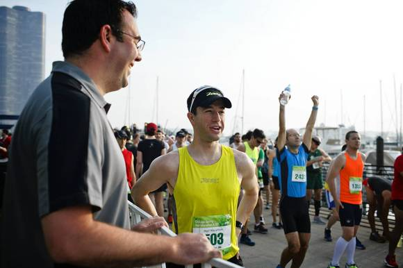 Dr. Philip Skiba (left) talks with Matt Ancona (right) before the beginning of the Chicago Spring Half Marathon Sunday, May 19, 2013 in Chicago.