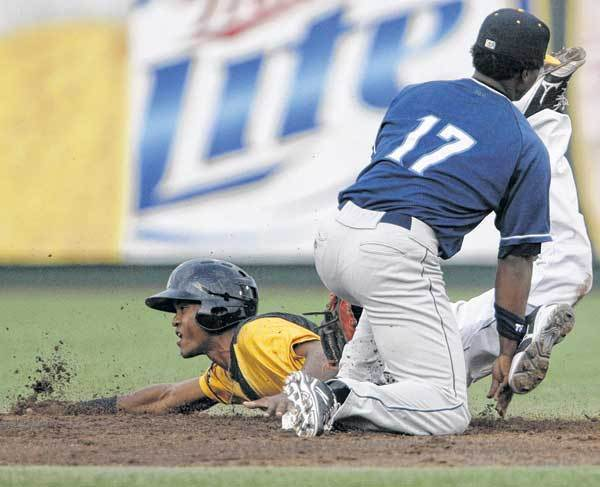 South Bend Silver Hawks' Socrates Brito slides safely into second in front of Lake County's Dorssys Paulino during Wednesday's minor league at Coveleski Stadium.
