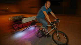 Pedal power:  Pedicab driver earns his living on the streets of downtown Orlando