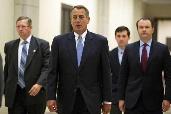 House Speaker John A. Boehner (R-Ohio) heads to a news conference on Capitol Hill in Washington.