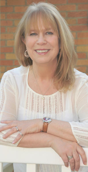 "Author and poet Laura Treacy Bentley is book editor for WV Living magazine. The Hagerstown native has just published a novel, ""The Silver Tattoo."""