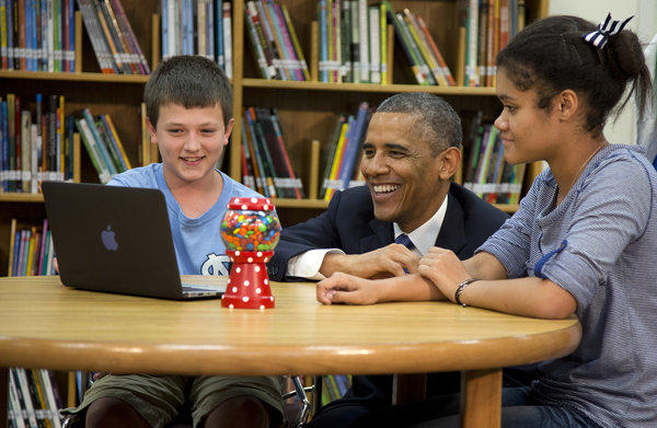 President Obama views a math project during a tour of Mooresville Middle School in Moorseville, N.C.