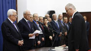 RAMALLAH, West Bank -- Palestinian President Mahmoud Abbas swore in a new government Thursday headed by a British-educated academic with no political experience.