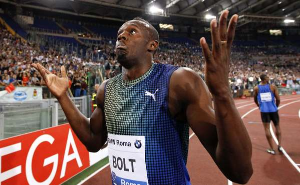 Usain Bolt reacts after Justin Gatlin edged him in the 100 meter race at the Golden Gala IAAF Diamond League at the Olympic stadium in Rome.